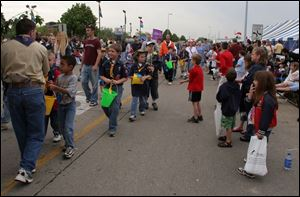 CTY oregfest22p 2 .jpg  Despite threatening skies and rain hundres of people lined Dustin road for the grand parade during the Oregon Festival in Oregon, OH 05/22/2005 The Blade/Lisa Dutton