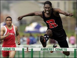 Darryl Elston of Rogers heads to a first-place finish in the 300-meter hurdles in the Division I regional at Amherst.