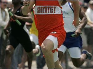 Aaron Waldie of Southview runs the final leg in the 800-meter relay which the Cougars won in 1:29:30 at the regional.