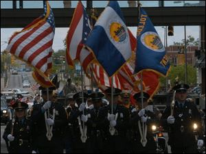 Toledo police lead the parade to honor those who have served in the U.S. military.