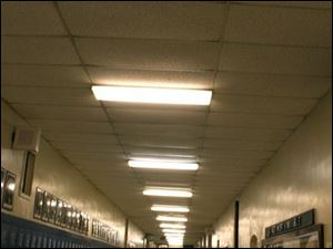 A hallway at Jones Junior High School is monitored by a ceiling-mounted video camera housed in a plexiglass bubble. The school is equipped with eight surveillance cameras.