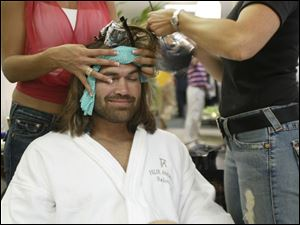 Boston Red Sox center fi elder Johnny Damon receives a makeover, but refuses to get his hair cut.