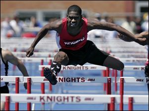 Rogers' Darryl Elston, center, was third last year in the 300 hurdles and returns to state as a favorite. He'll also run in the 110.