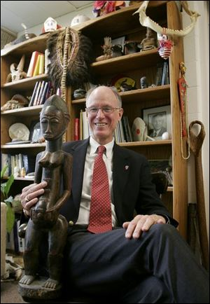 Phineas Anderson has been head of Maumee Valley Country Day School for 11 years. He has visited nearly 100 countries and keeps many of the artifacts he has collected in his office.