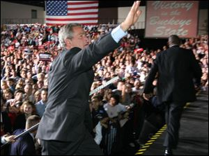 President Bush made a campaign stop in Toledo in October. During the event, the President met backstage with Tom and Bernadette Noe, hugging each of them.