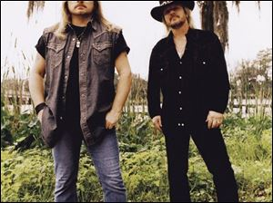Johnny Van Zant, left, and brother Donnie.