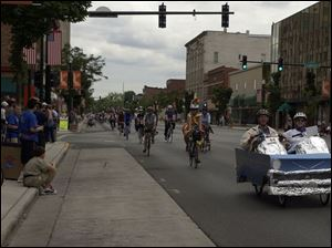 Some 500 bike riders parade down Findlay's Main Street to mark the opening of the weeklong Great Ohio Bi
