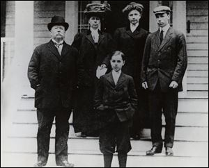 Governor Taft's great-grandfather, former President William Howard Taft, left, and his grandfather, future Sen. Robert A. Taft, right, are captured in a 1918 photo of the family.