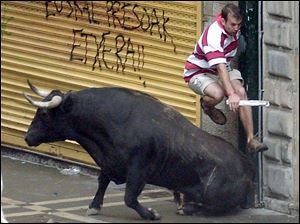 The weeklong festival in Pamplona, Spain, features daily runs with the bulls, which often entail close encounters with injury.
