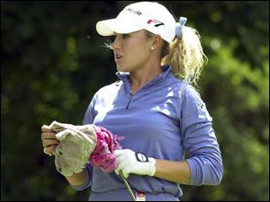 Natalie Gulbis has been best known for fashion shoots and calendars but her golf game is quickly catching up.
