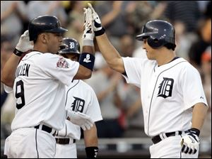 The Tigers' Magglio Ordonez, right, homered in his first game back in Detroit after completing a rehab assignment in Toledo.