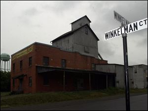 A street sign in Ottoville, at left, has been one of the few remaining traces of the Winkelman family, which once was prominent in the village.