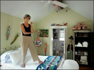 Innkeeper Tina Mather-Bothe shows off the interior of her Little Purple House bed and breakfast in Perrysburg.