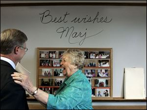 Marjorie Faust, 81, who has retired after holding a succession of public service jobs, enjoys a humorous moment with Ottawa County Commissioner Steve Arndt.