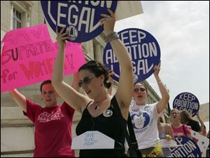 Protesters from the National Organization for Women oppose President Bush's Supreme Court choice.