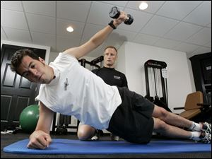 Sam Hornish Jr. works out in his Napoleon home for trainer Jim Leo of PitFit Training.