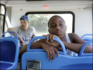 Cliff McCormick, left, and Prentiss Gray use TARTA's Sylvania Call-A-Ride service. It showed sizable gains in riders.