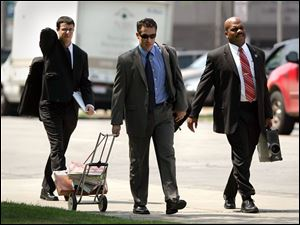 Justin Meeks, left, and Del Wright, Jr., right, of the Department