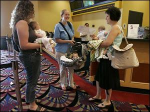 Moms and babies getting ready to see a movie at Showcase