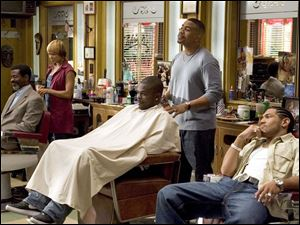As Romadal (Dan White, right) goofs off, Calvin (Omar Gooding) and Terri (Toni Trucks) work on clients in the Showtime series Barbershop, premiering tomorrow night.
