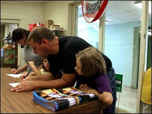 Stacey and Todd Stec enroll their girls in Crossgates Elementary