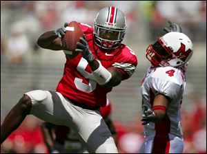 Ohio State s Donte Whitner intercepts a pass intended for Miami s Josh Williams and returns it for a touchdown.