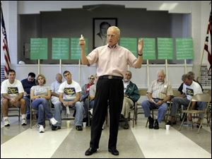 Carty Finkbeiner rallies his supporters at a meeting yesterday.