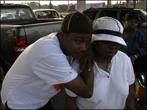 Duone Reese and his wife, Angela, wait for fuel at a gasoline station in Pascagoula, Miss. They arrived early and waited nearly three hourse because fuel is scarce.