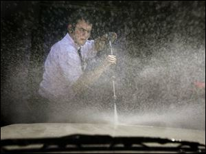Pleasant weather is sending area motorists to car washes, such as the Minuteman on Monroe Street, where Luke Rhodes uses a pressure washer to dislodge the bugs from a windshield.