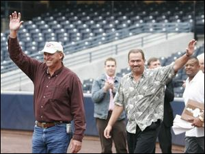 Manager Larry Parrish, left, waves as the team s representative.