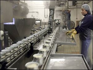 Annete Salinas works on the production line in the Fremont Co. s processing plant.