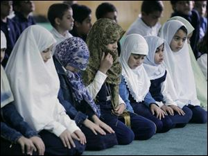 Students pray at the Masjid Saad School in Toledo in preparation for Ramadan, which will begin Wednesday.
