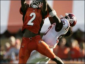 BGSU cornerback Jelani Jordan steals a pass intended for Temple receiver Bruce Gordon, one of two interceptions for him against the Owls. The Falcon