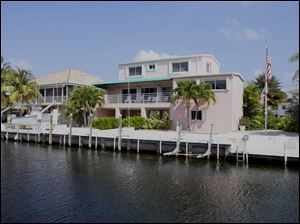 In 2002, Tom Noe wrote a check for $43,773 to landscape this waterfront home in Islamorada, Fla. The attorney general says Mr. Noe forged the check to allow him access to funds to pay for the landscaping.