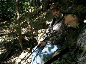 Tim Ayer and his daughter, Samantha, chat while hunting for squirrel. Even though they came up empty on this day, it was far from a total loss and a worthwhile experience for both.