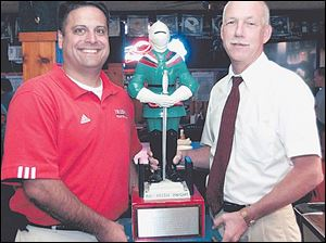 The Irish Knight is a valuable possession for Central coach Greg Dempsey, left, and Dick Cromwell of St. Francis.