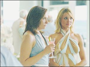 Toni Collette, left, and Cameron Diaz play feuding sisters in director Curtis Hanson s In Her Shoes.