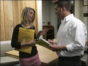 Sarah Tomashefski, now 26, talks with council candidate Gordy Heminger after a Bowling Green City Council meeting. After serving since 1999, she is not running for re-election.