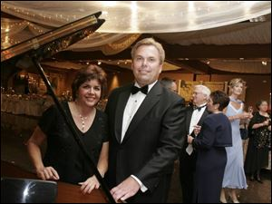 SWEET MUSIC: Kim and Bob LaClair form an elegant duo at the 45th Sapphire Ball to benefit the Toledo Opera.