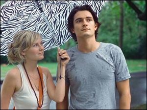 Kirsten Dunst plays a flight attendant attracted to a man (Orlando Bloom) who returns to