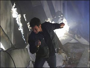 Kirk Cameron, starring as reporter Buck Williams, escapes from a burning building as World War III breaks out in a scene from the movie Left Behind: World at War.
