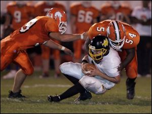 Southview s Nick Warren (54) sacks Northview s Mike Schneider as teammate Chris Mierzwiak closes in.