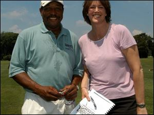 TO THE POINT: Chuck Ealey and Christine Brennan get straight to the point: the importance of the Connecting Point's golf outing at Heather Downs Country Club. The pair will be hosts for next year's event.