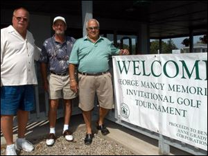 FORE GEORGE: From left, Brian Gump, Tim Corcoran, and John Mancy prepare to play golf in memory of Mr. Mancy's brother, George, at Whiteford Valley.