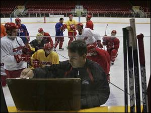Storm coach Nick Vitucci prepares his players for their ECHL opener tomorrow night against Dayton at the Sports Arena. Last season Vitucci led the Storm into the playoffs with a 41-26-5 record. As a player, Vitucci was a member of five title teams.