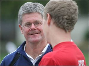 Toledo Christian coach Steve Pereus talks with Ben Tipping, an All-TAAC second-teamer.