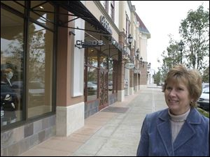 For Christy Burgei, who drives to the center from Napoleon, the variety of retailers is the attraction.
