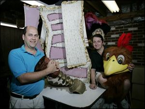 Gregg Kerns, left, president of Costume Holiday House Inc. in Fremont, and designer Alex Poznanski show some of their cr