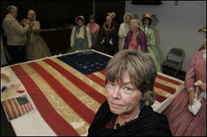 Textile conservationist Jane Hammond spent 400 hours restoring the 34-star flag once carried by the 21st Ohio Infantry. It will soon be displayed at the Hancock Historical Museum.
