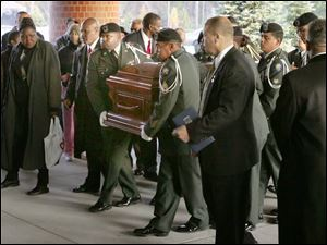 The casket of Rosa Parks is moved into the Greater Grace Temple in Detroit for the seven-hour funeral service.